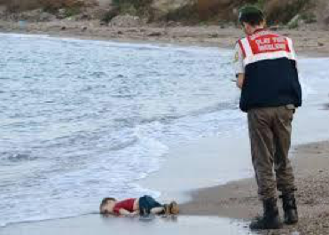 Drowned Syrian child refugee Alan Kurdi washed ashore in Bodrum, Turkey, September 2015.