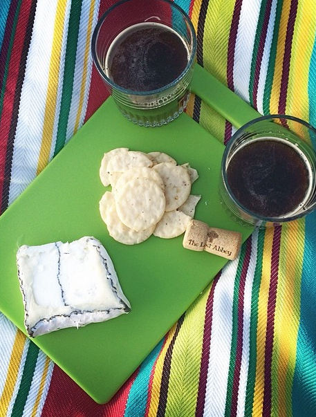 Cheese + beer sunset appetizers (Cypress Grove Humboldt Fog Goat Cheese + Lost Abbey Santa Maria Ale) with our new picnic blanket and cutting board, courtesy of Jeff's family for our one year anniversary.