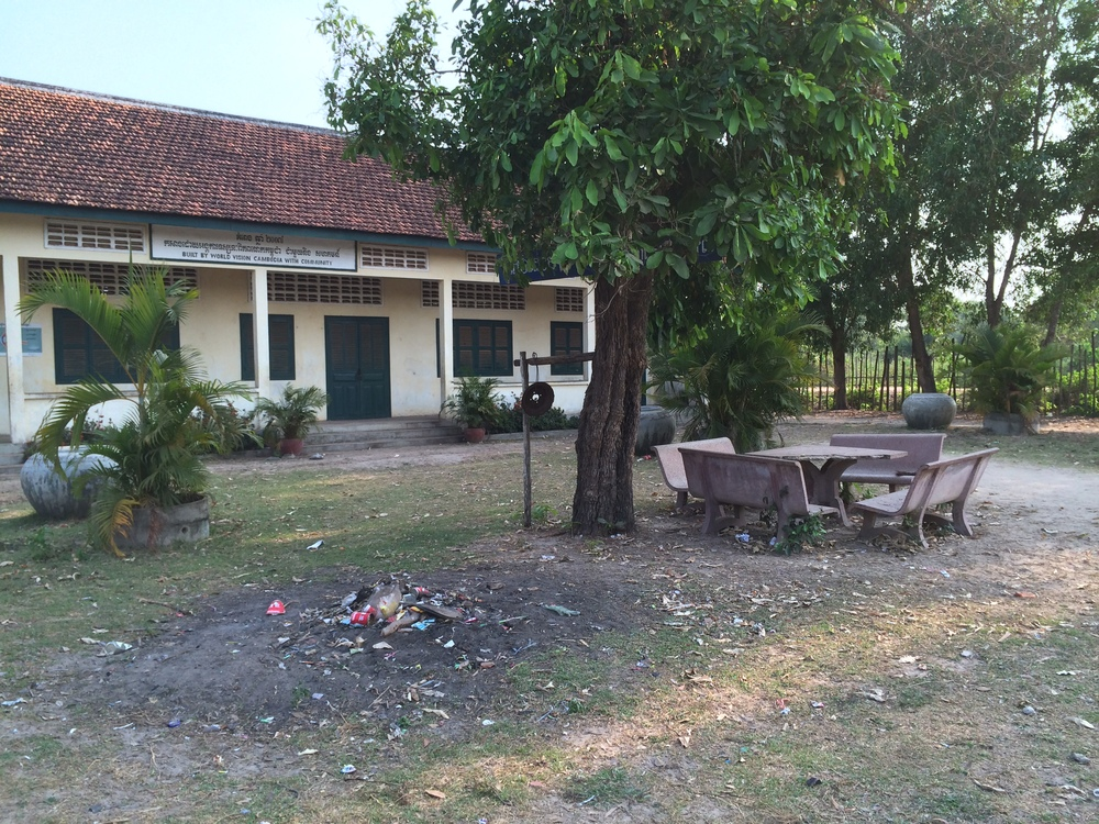 A Cambodian school.  Notice the pile of trash out front.