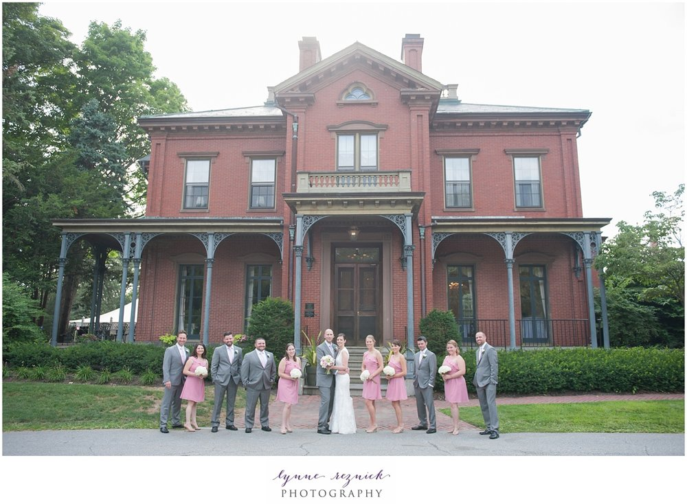 bridal party in front of the impressive brick Commander's Mansion in Watertown MA
