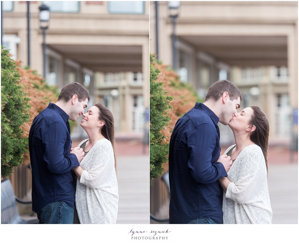 Boston Harbor Hotel kisses during windy engagement session