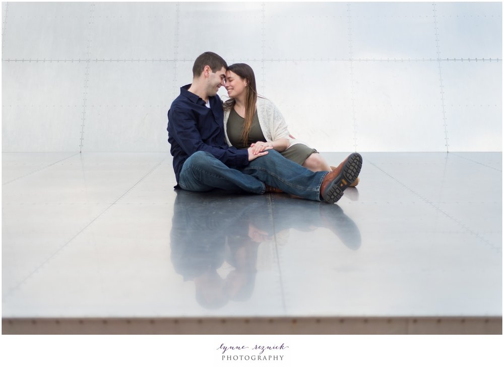 Boston Harbor artwork makes the perfect backdrop for engagement pics