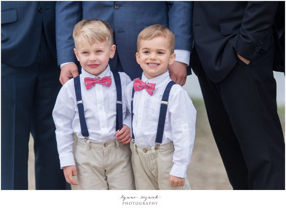 preppy ring bearers in suspenders and pink bow ties