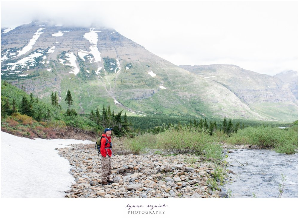 hiker admires mountains on Swiftcurrent Pass trail