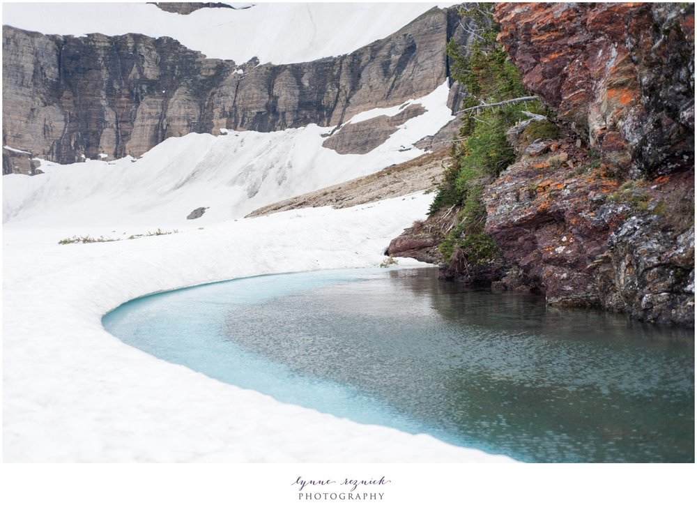 frozen waters of Iceberg Lake in June