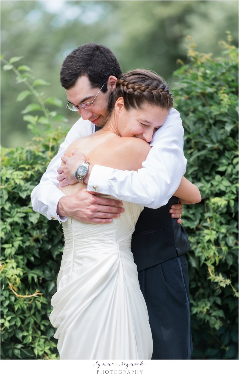 First look hugs for bride and groom at Bradley Estate Summer Wedding