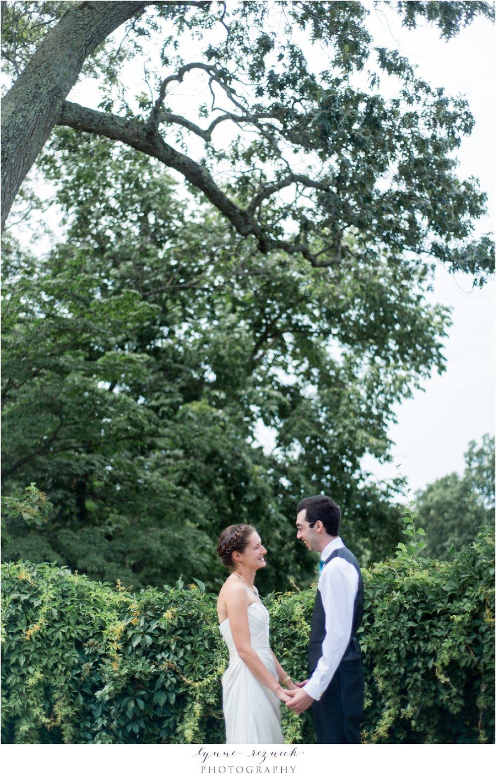 Bride & Groom hold hands on lawn of Bradley Estate before wedding