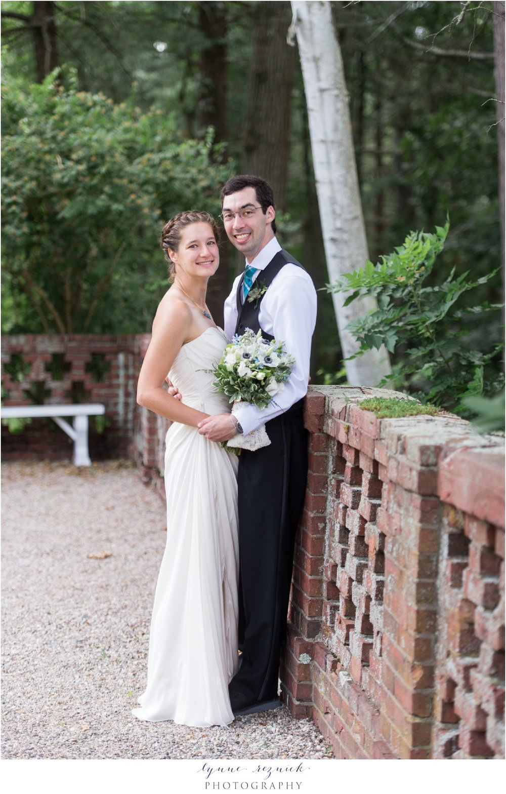bride and groom in the formal gardens of eleanor bradley estate