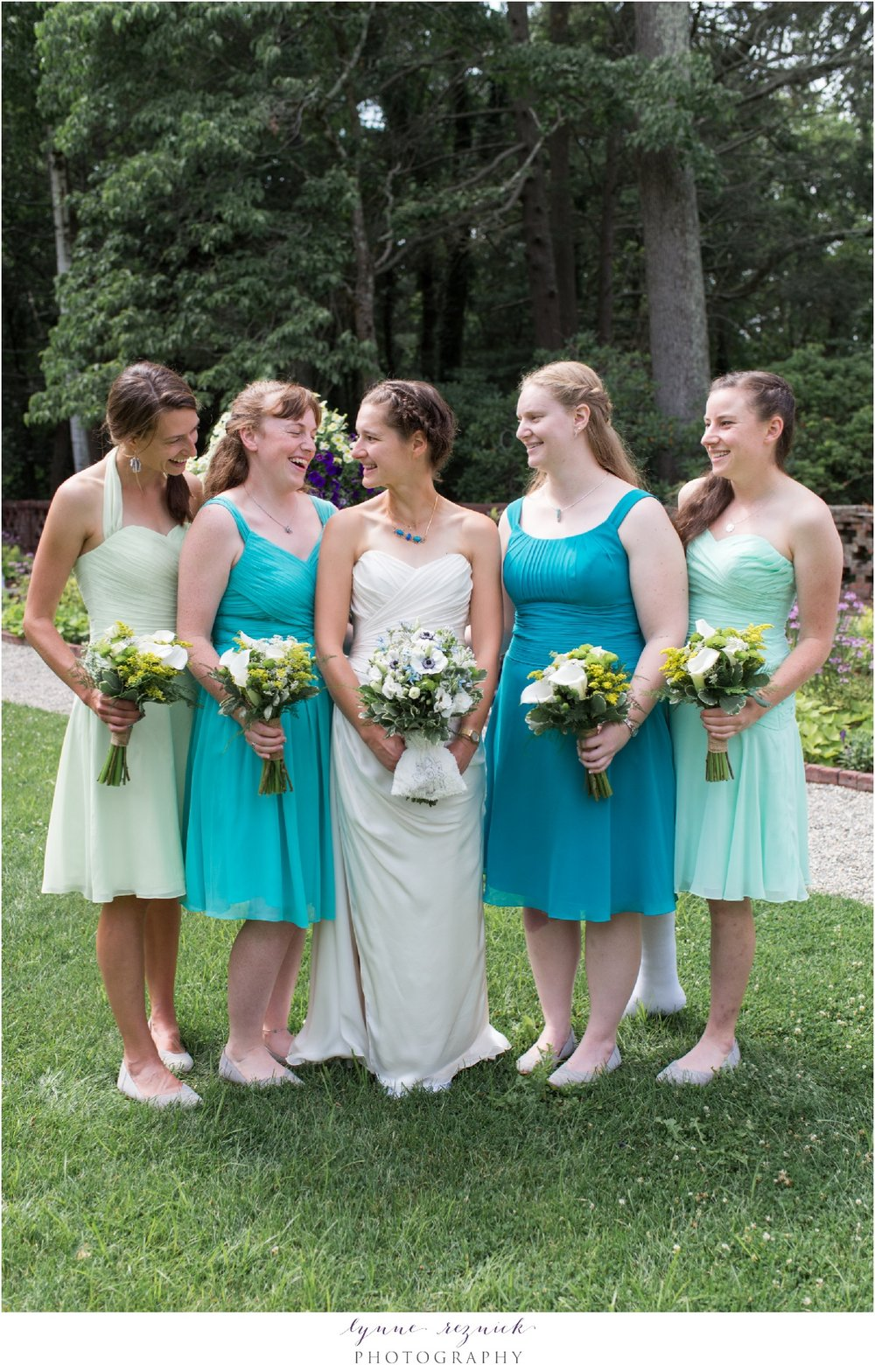 bridesmaids pose in summer blooms of gardens of Bradley Estate