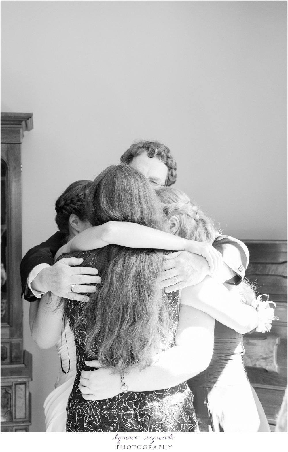 family hug inside the Bradley Estate