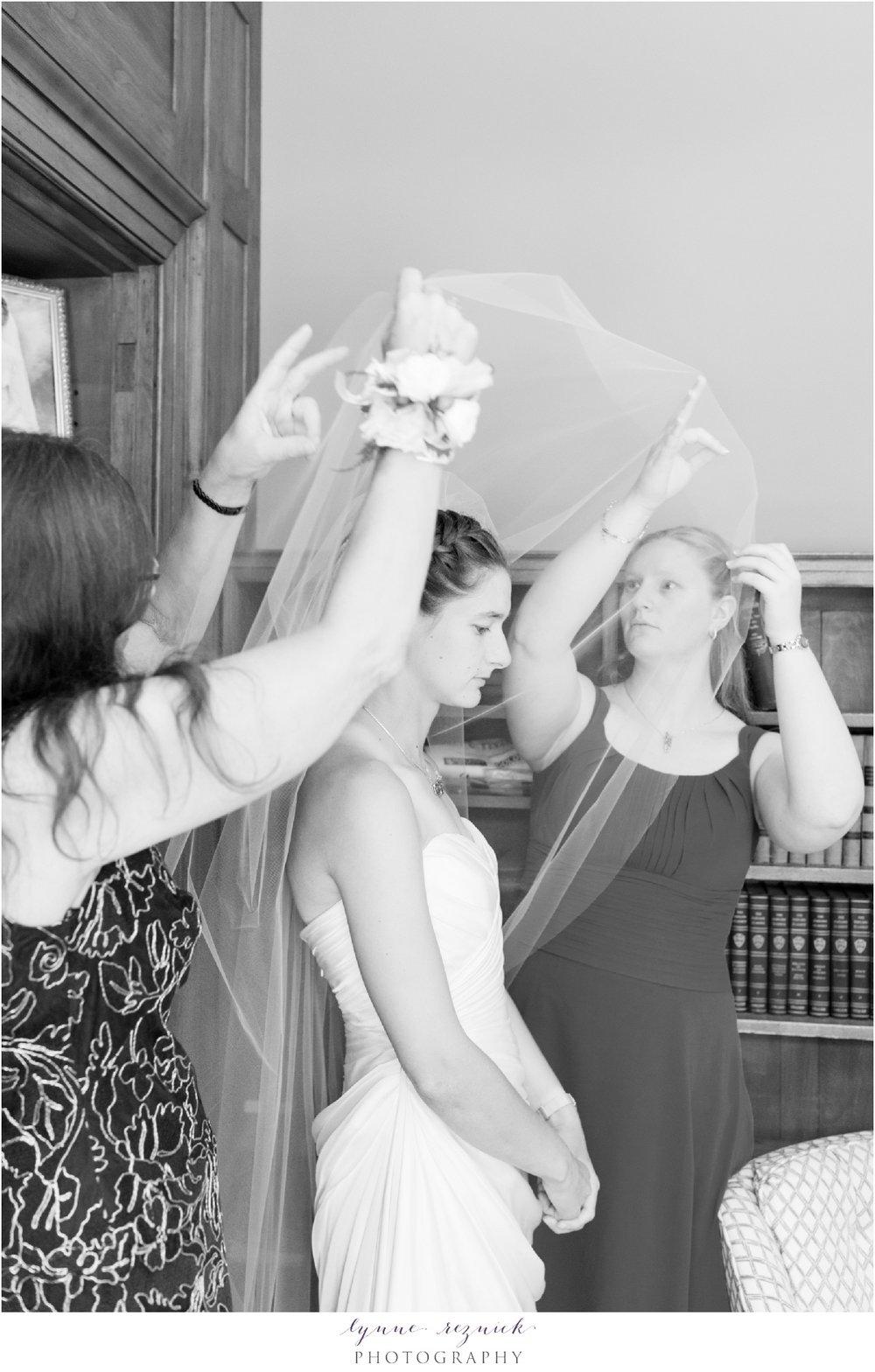 bride puts on her veil before Bradley Estate wedding ceremony