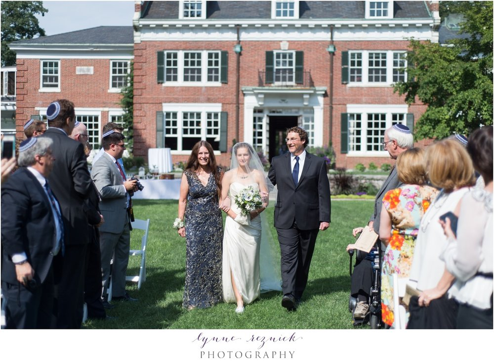 bride and parents walk down aisle at sunny bradley estate wedding ceremony