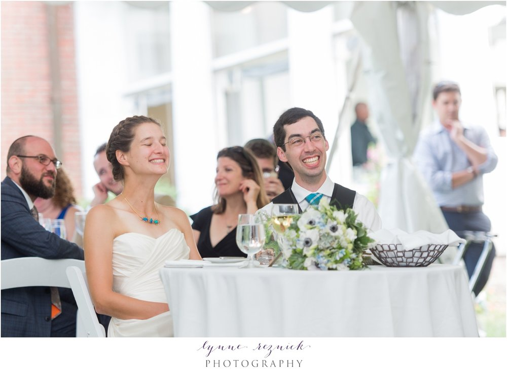 bride and groom laughing during toasts during tented Bradley Estate wedding reception