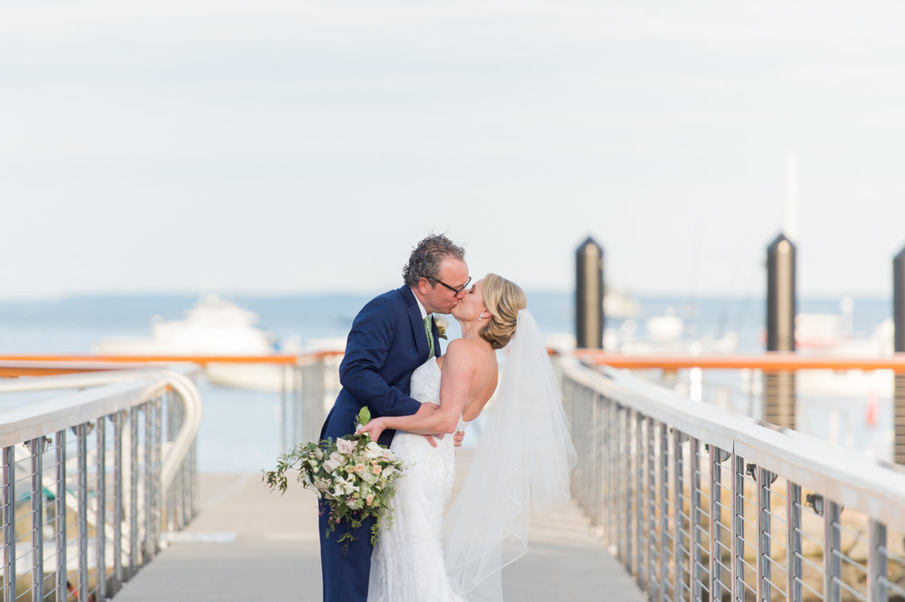 bride and groom dip on the dock at their belle haven club wedding