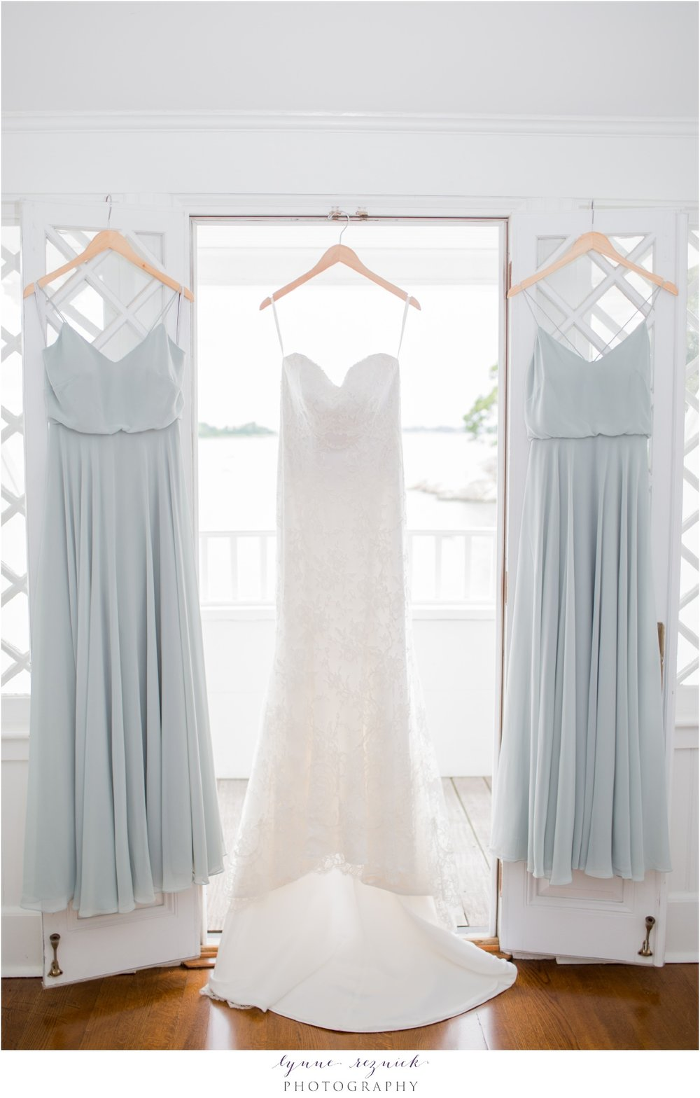 stunning bridal gown and bridesmaids dresses for chic nautical wedding at belle haven club in greenwich CT