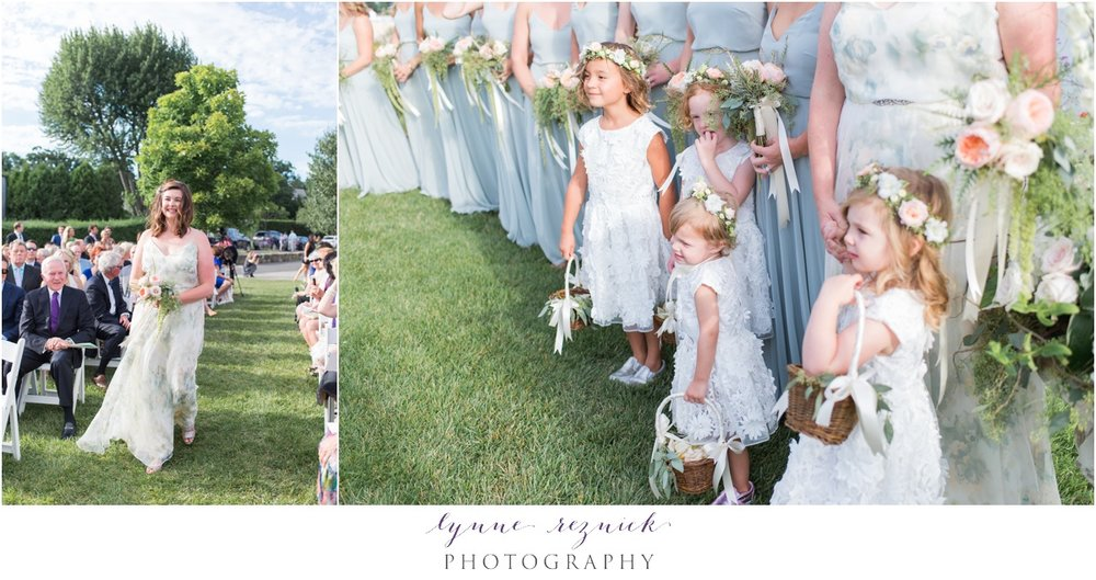 flower girls and bridesmaids during chic nautical wedding ceremony on belle haven club lawn