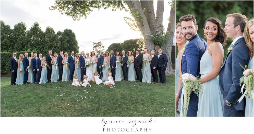 large bridal party on back lawn of belle haven club