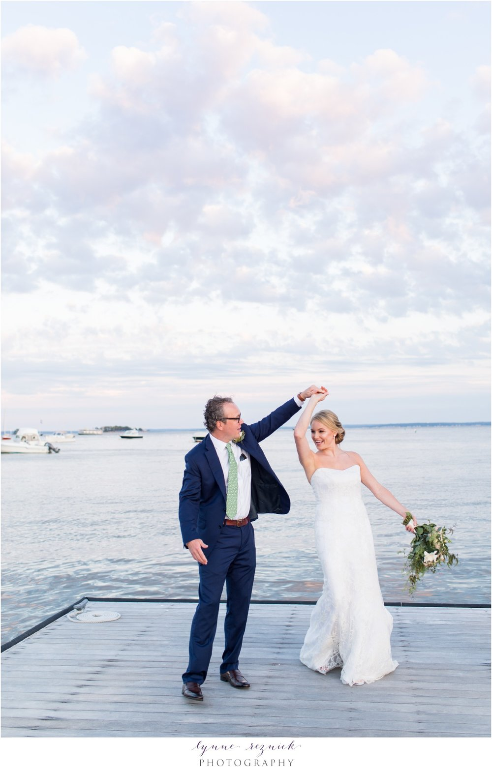 bride and groom dance on the dock at sunset at belle haven club greenwich ct