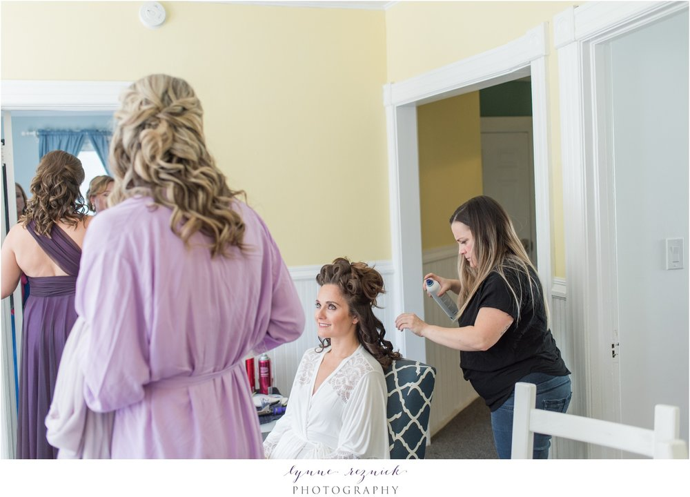 bride getting ready hair and makeup Mystic Seaport wedding