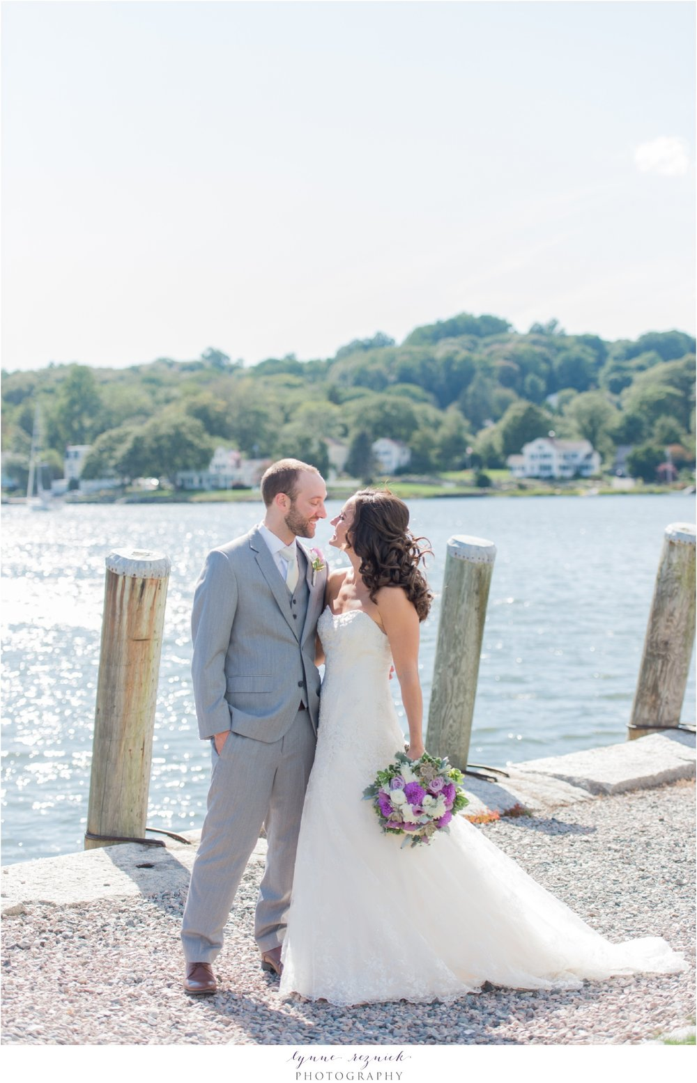 sunny first look over the water Mystic Seaport wedding couple