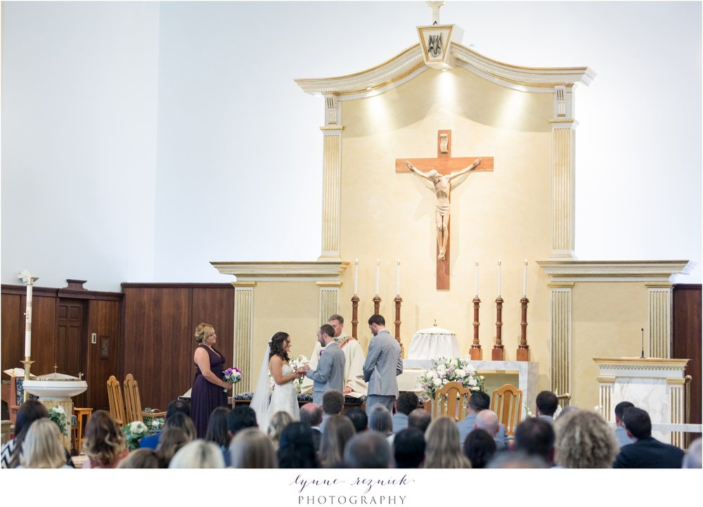 vows and exchanging rings St. Mary Church Stonington CT Wedding