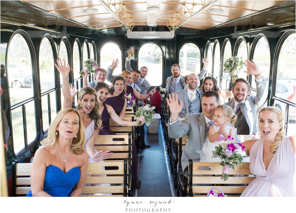 bridal party trolley ride to reception at latitude 41