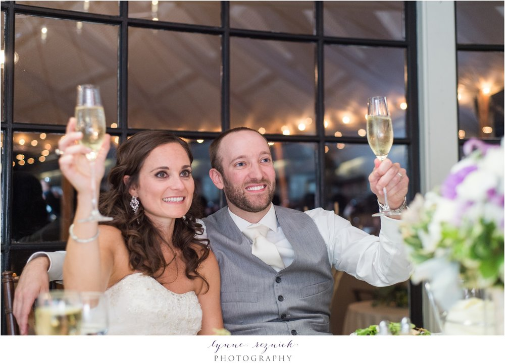 toasts to bride and groom at nautical chic Latitude 41 wedding