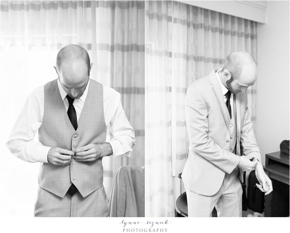 groom getting ready for fall saphire estate wedding in gray suit