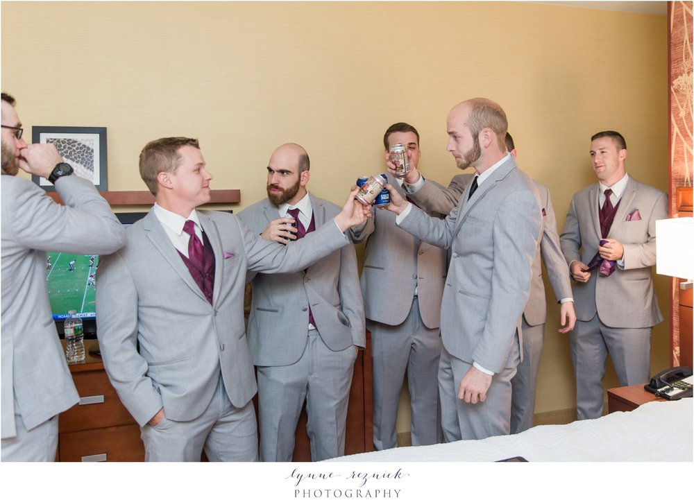 groom and groomsmen toast during getting ready for saphire estate wedding