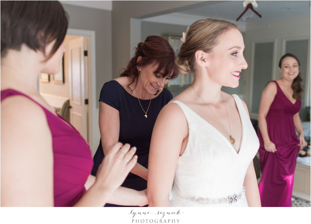 mom helping bride get ready at saphire estate bridal suite for fall wedding