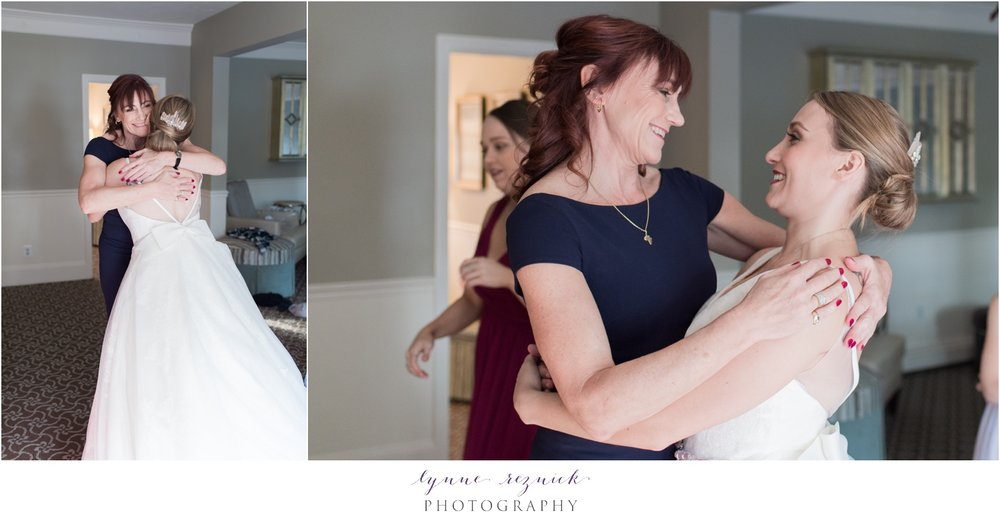 mom helping bride get ready at saphire estate bridal suite for fall wedding  in white by vera wang gown for davids bridal
