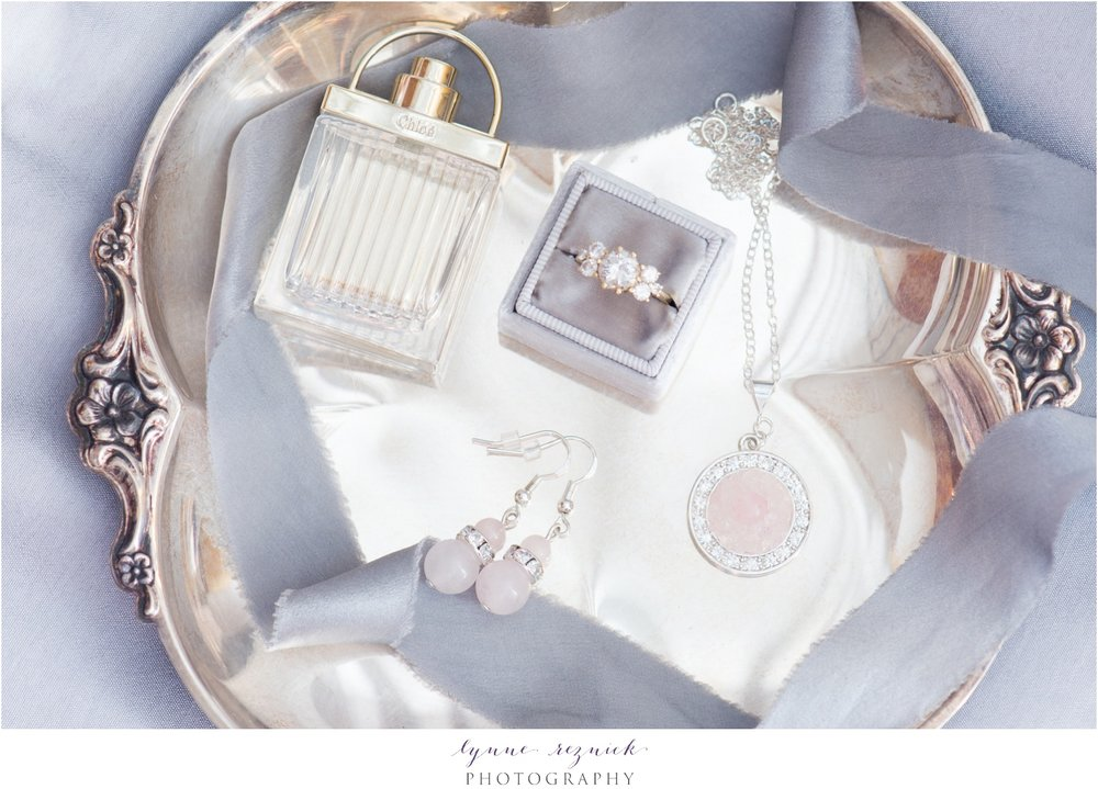 bridal details flatlay gray and rose quartz mrs box and engagement ring