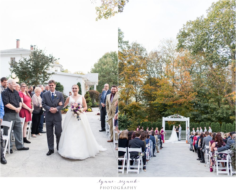 outdoor fall wedding ceremony in courtyard at saphire estate in october