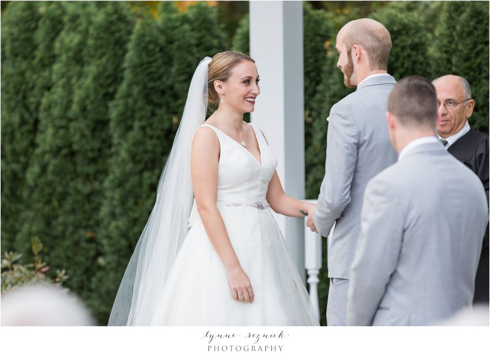bride and groom getting married in outdoor wedding ceremony at saphire estate in the fall
