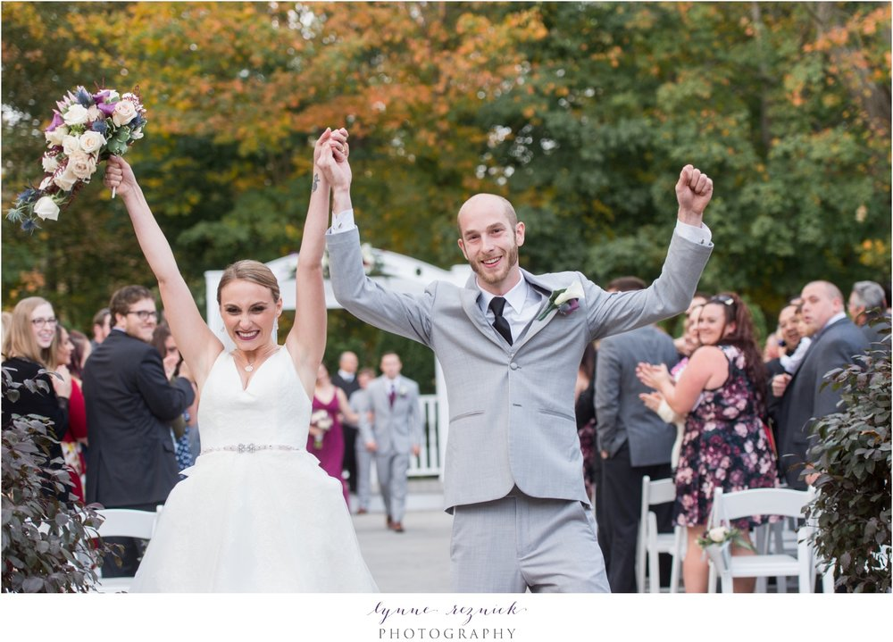 husband and wife walk down aisle at saphire estate fall wedding