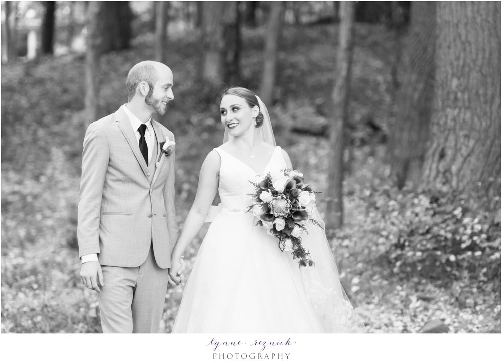 bride and groom walking at fall wedding at saphire estate in MA