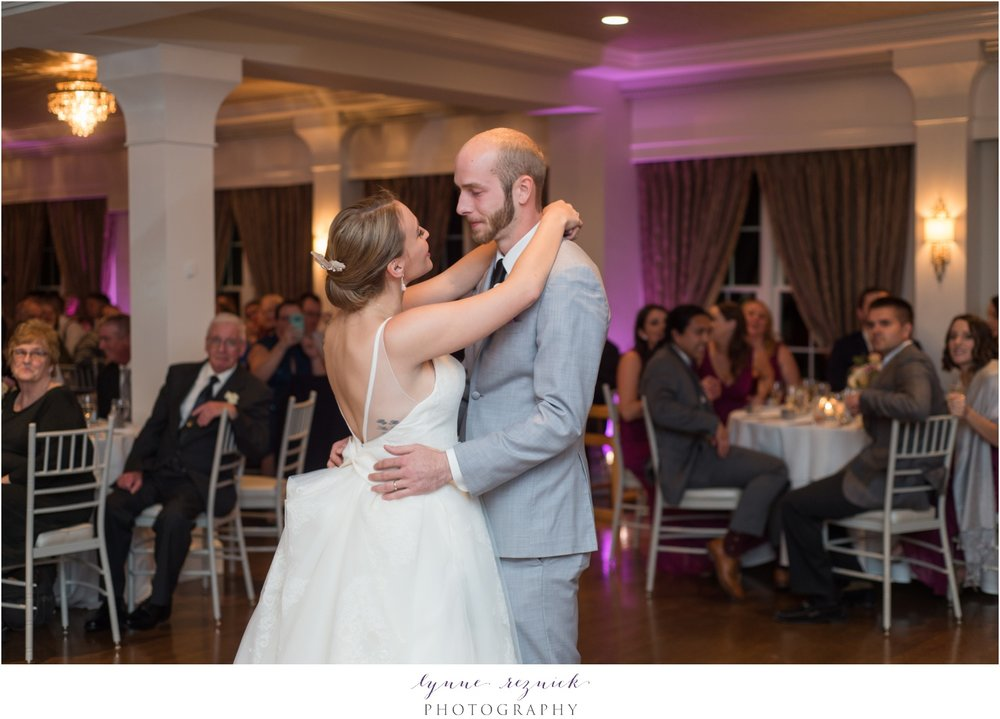 first dance at fall saphire estate wedding with pink uplighting