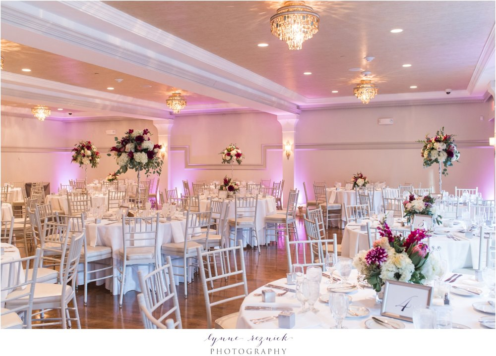 reception decor and flowers at fall saphire estate wedding