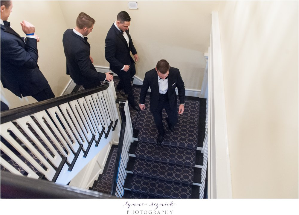 Stamford yacht club shoreline wedding guys on stairs getting ready