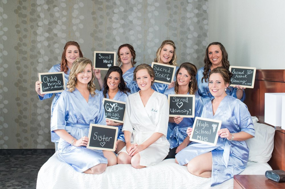 chalkboard signs for how you know the bride in satin robes bridal party