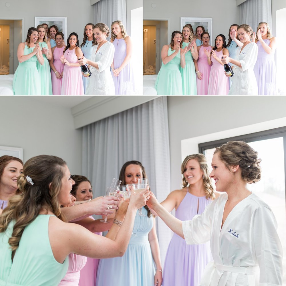 bride and bridesmaids champagne toast before spring wedding