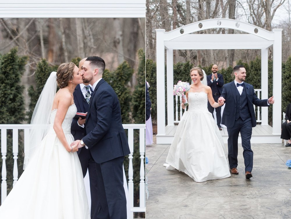 first kiss during outdoor ceremony at saphire estate in spring time