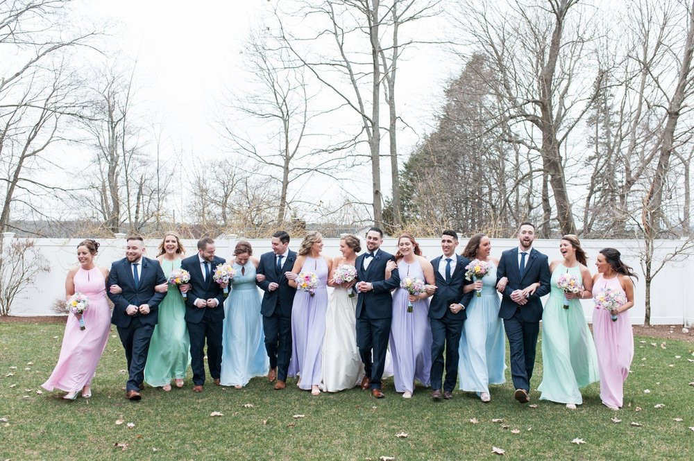 navy and pastel bridal party at spring saphire estate wedding