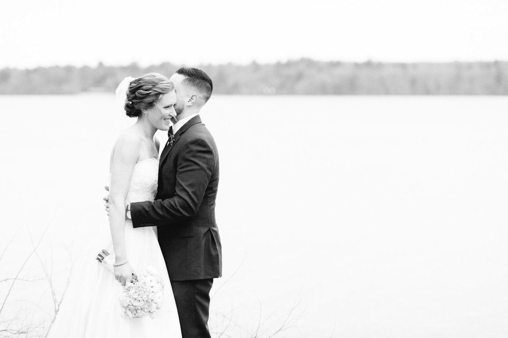 couples portraits on the water at saphire estate wedding MA black and white