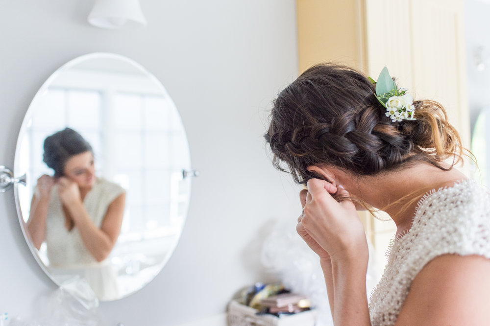 getting ready bridal braid and pearl dress