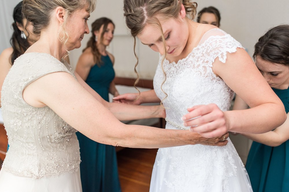 bride getting ready with her mom for rustic chic new hampshire wedding on Lake Spofford