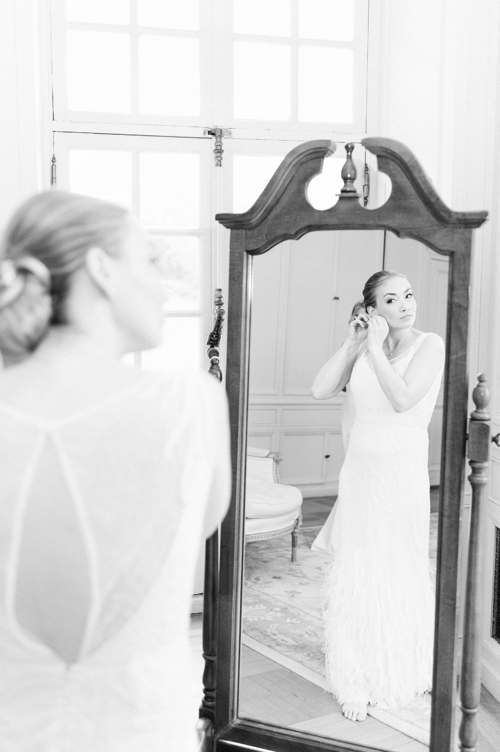 glen manor house wedding bride getting ready in rosa clara wedding dress with feathers and beading