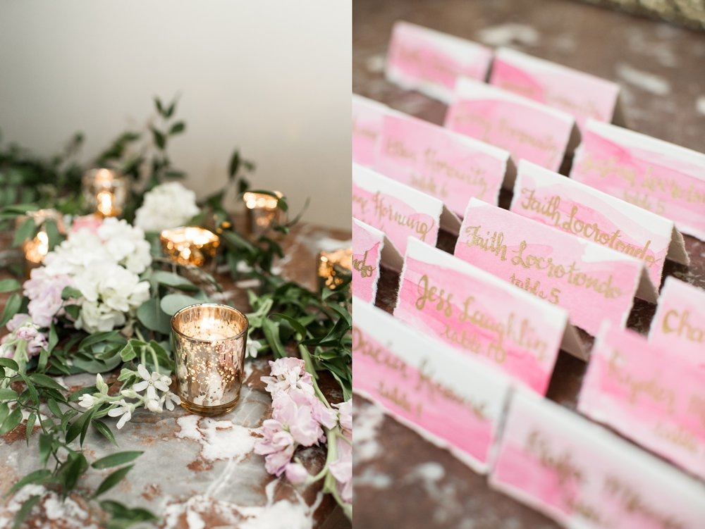 pink watercolor escort cards with gold calligraphy at glen manor house wedding