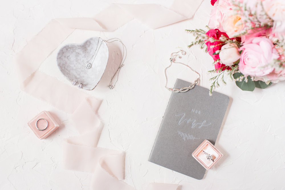 glen manor house wedding bridal details with blush florals and jewelry quinn luu creative studio vow books