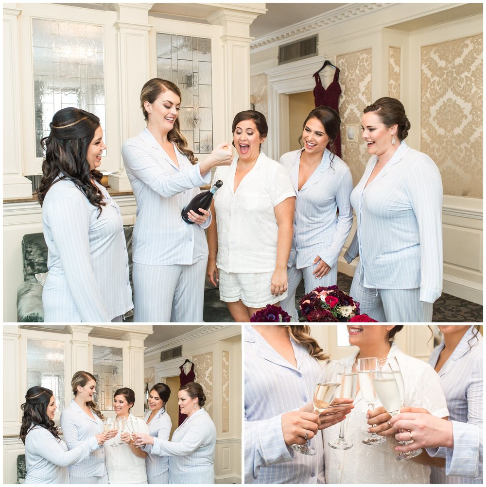 bride and maids getting ready at Lenox Hotel Boston with champagne toast in cute pjs
